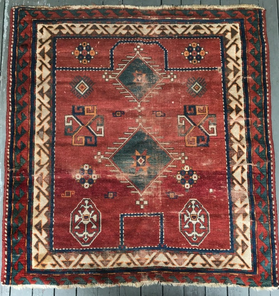"Antique Kazak rug, nearly square 4'x4'2"", gorgeous vegetable dyed colors. Lambs wool with areas of soft pile, and low pile. One small hole"