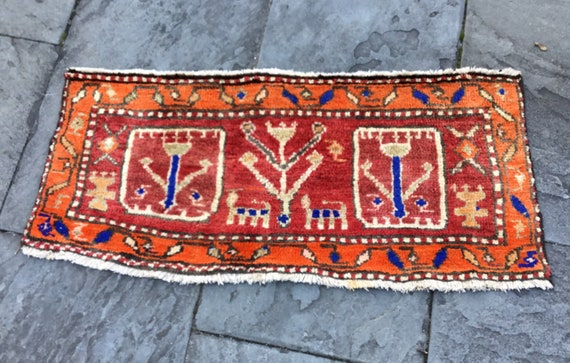 Antique Heriz mat, Orange, pink, blue. Nice fading of color. Vegetable dyed wool on cotton foundation. Collectible