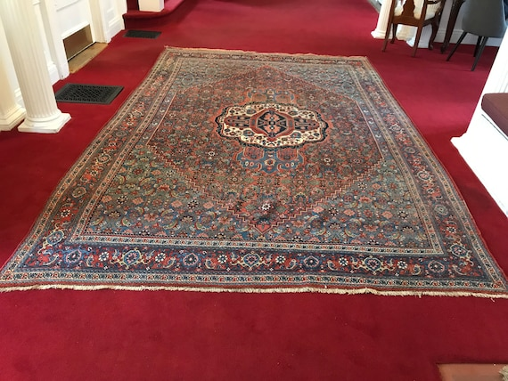 SOLD Wonderful Antique Tribal rug, hand knotted using vegetable dyedwool. 8 x 11. SOLD