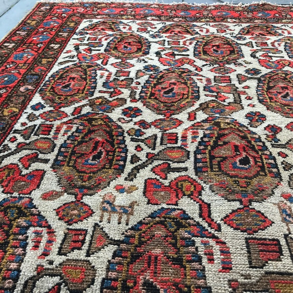 Boteh  rug. Antique tribal rug, paisley rug with small animals, Distressed Caucasian rug. NW Persian Antique rug, wonderful tribal motifs