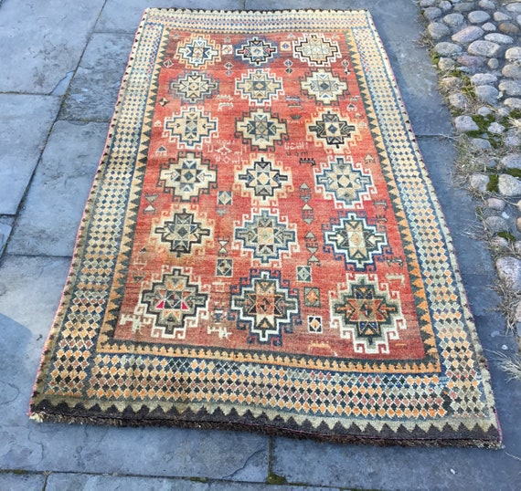 SOLDAntique tribal rug. Rust red vegetable dyed field with animals andgeometric medallions. All wool.  fading and abrash. SOLD