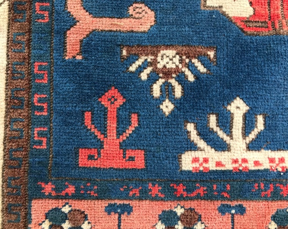 Early 20th century Turkish rug, wonderful motifs, faded colors, low pile