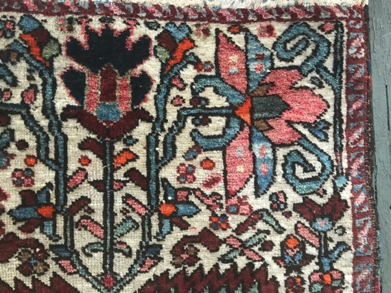 Antique Heriz rug. Impeccable condition for age. c1900. Beautiful vegetable dyed colors with abrash, pinks, blues, orange on Ivory field.