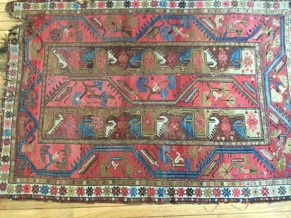 Old Caucasian rug, 19th century antique rug, very worn and beautiful.  Gorgeous vegetable dyed wool. Antique fragment with wear. Karabagh.