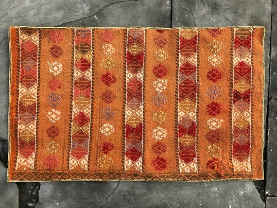 Pretty little vintage kilim. All wool, hand knotted and embroidered.  Orange,  quite old