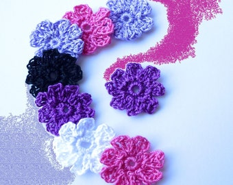 8 flowers in shades of pink and purple hook
