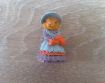 Lady figurine rabbit watering her garden