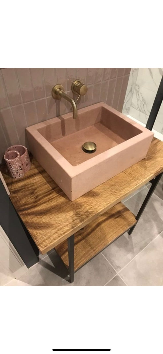 Pastel pink bathroom concrete sink