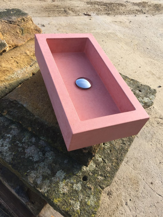Pastel pink concrete trough sink
