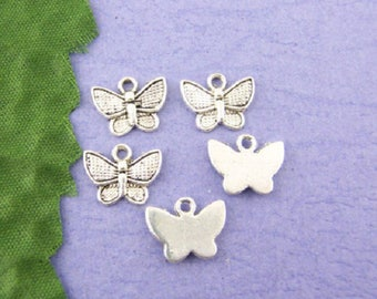 5 Butterfly handmade charms in silver
