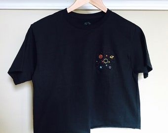 black tshirt with solar system embroidery