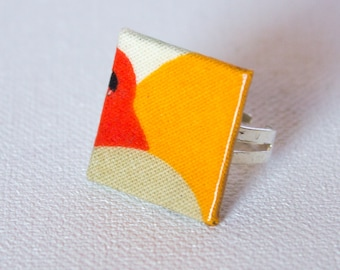 Square ring in orange, red and grey patterned fabric