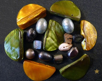 Mother of various shapes beads of green, ochre, grey