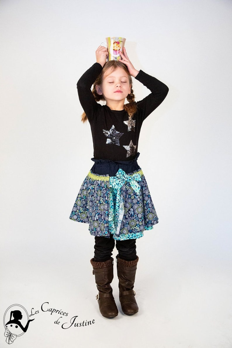 Ruffled girl skirt with neon turquoise blue elastic waist with floral and mandala motifs from 2 years to 8 years old