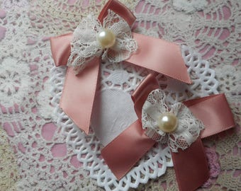 Pink satin bows with white lace and Pearl 7,00 cm in height (with 2 bows).