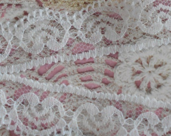 Fine white heart patterned scalloped lace non elastic finely perforated polyester 2.50 cm width