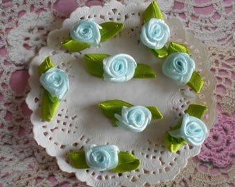 Sky blue satin roses and green leaves of 2.50 cm long (with 10 flowers).