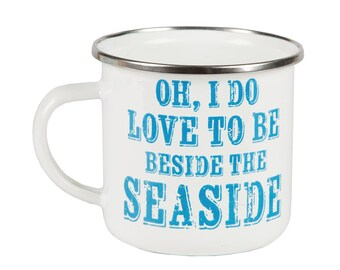 Enamel mug next to the edge of sea - Beside the Seaside