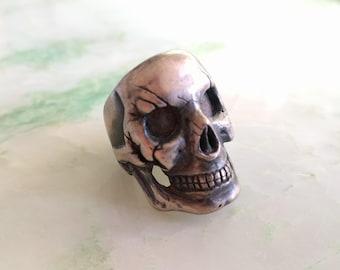 Gnarled Silver Skull