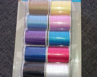 set of 10 spools of thread sewing various colors