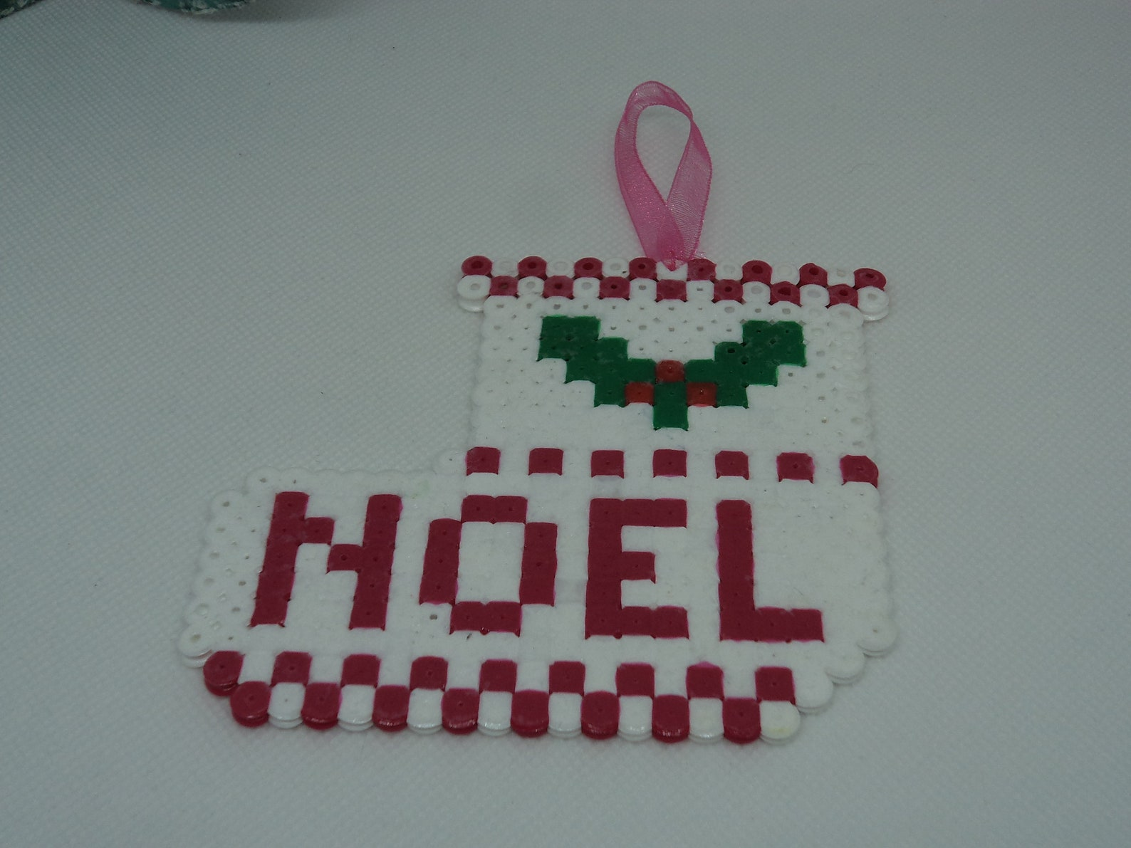a ballet shoe christmas with its holly in pearls hama (pixel art) for the front door, the top of the tree or fireplace