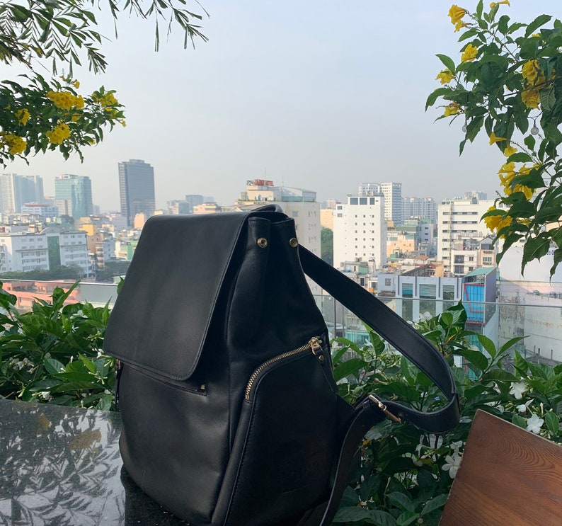 Women/'s Black Leather Backpack- bold blue interior- travel timeless weekend bag laptop