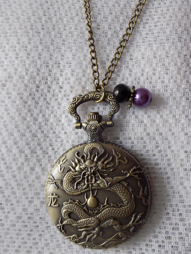 necklace necklace pendant necklace shows chinese sign pocket bronze metal beads. glass beads snake black and purple colors