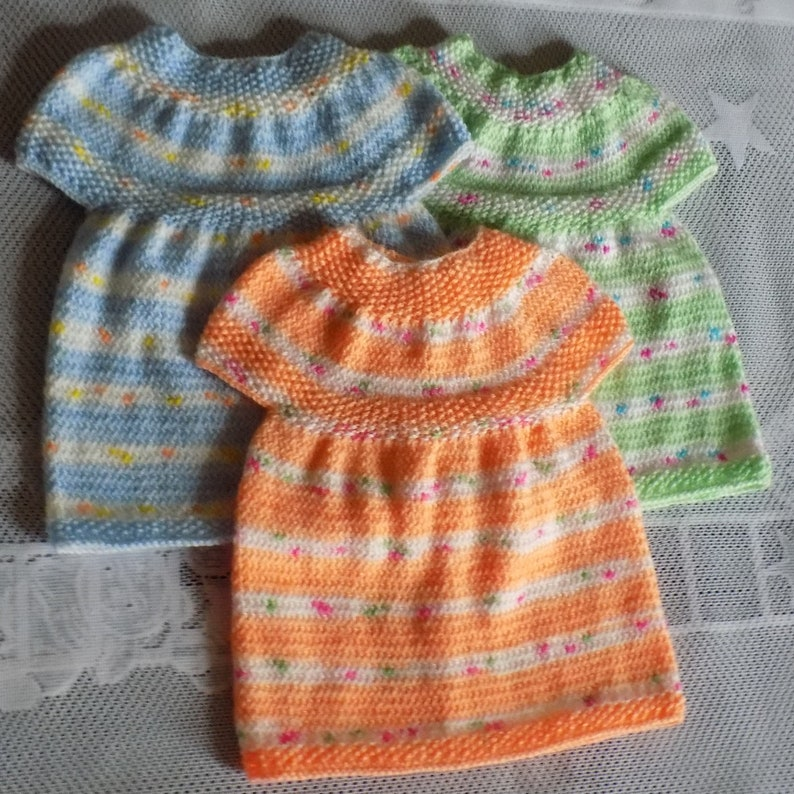 Baby dress handmade knitted,3 colors available birth size at 3 months.