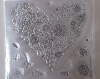 Stamp Clear (transparent) representing a heart filled with flowers and 10 small round pads