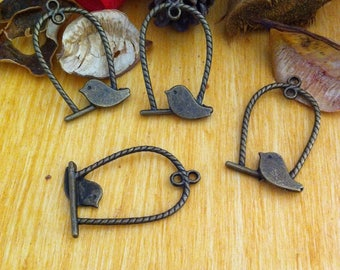 4 perch with bird, twisted round, bronze tone charms pendants