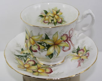 Paragon Teacup and Saucer - Yellow Orchids w/ Pink Ribbons & Lily of The Valley - Vintage - Gold Gilded