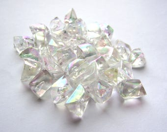 Set of 32 iridescent transparent crystals of plastic with air bubbles