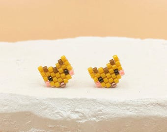 The Tigrrrrre ear studs