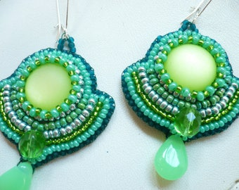 Earrings embroidered in shades of green beading.