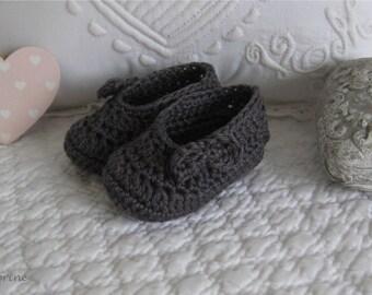 Mini baby booties crocheted in dark gray cotton