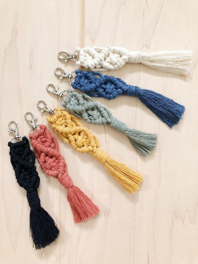 Pretty white macram\u00e9 key chain with beads