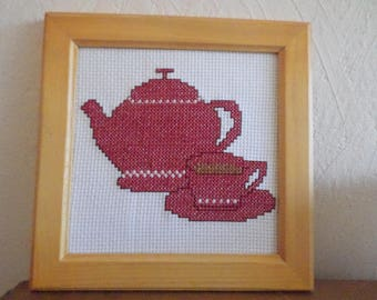 framed cross stitch: a teapot and Cup