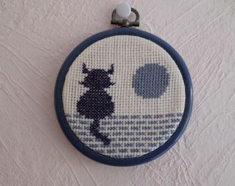 framed cross stitch: a cat
