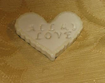 "Natural off-white heart magnet with embossed ""All My Love"", scalloped sides, and glitter border design"