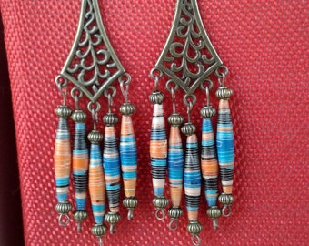 Earrings made of recycled paper and varnished