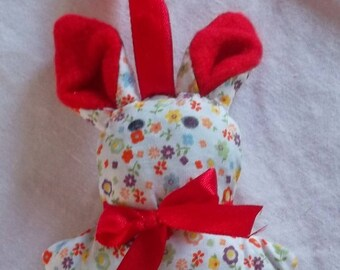 A plain Lavender Bunny and red floral design
