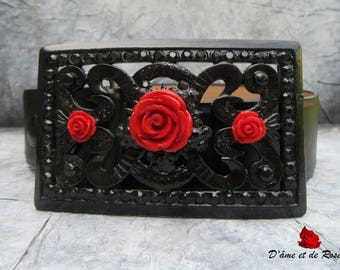 1 black bow belt and three red roses with leather belt