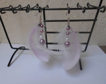 Purple and white earrings with feathers