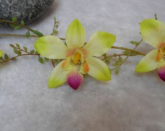 Artificial green lime and fuchsia Orchid