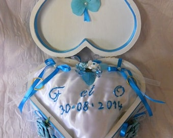 wedding ring cushion in turquoise and white heart