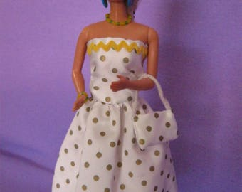 Short dress has small green dots (B159)