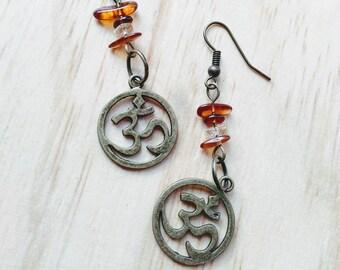 Om earrings and amber