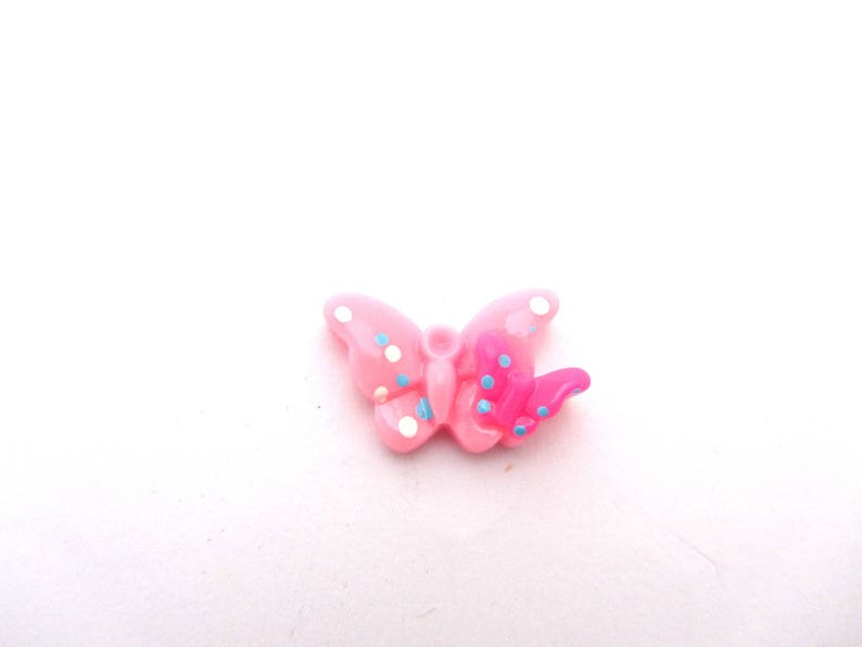 1 half beads butterfly in light pink resin with peas to be stuck