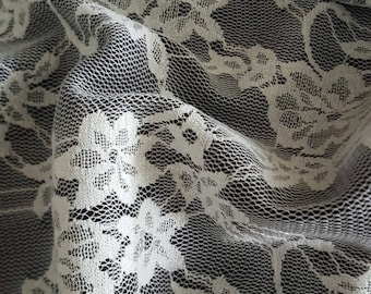 1 meter of white lace on black satin