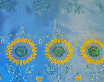 Coupon of turquoise satin patterned sunflower glitter 85 x 55 cm